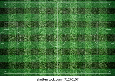 Soccer field with white lines on grass