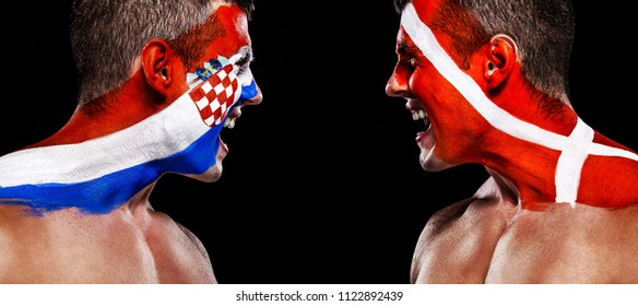 Soccer or football fan with body art on face with aggression - flag of Croatia vs Denmark.