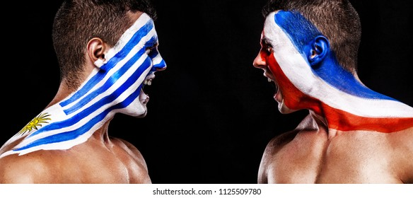 Soccer or football fan with bodyart on face with agression - flags of Uruguay vs France. Sport Concept with copyspace.