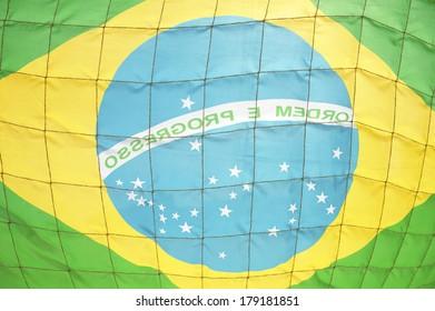 Soccer football net Brazilian flag background