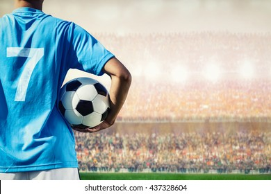 soccer football player in blue team concept holding soccer ball in the stadium