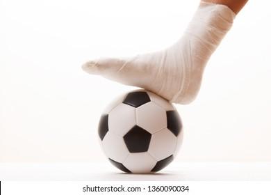Soccer football player and sport plaster foot leg,  ball.