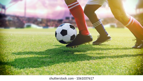 soccer or football player standing with ball on the field for Kick the soccer ball at football stadium,Soft focus