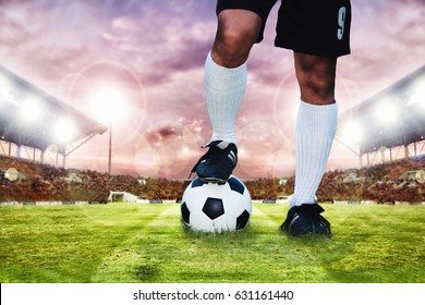 soccer or football player standing with ball on the field for Kick the soccer ball ,blurry and soft focus