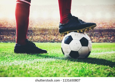soccer football player tread on the ball at kick off line