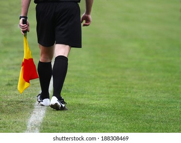 Soccer football referee linesman with a flag.