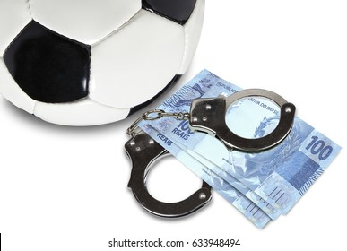 Soccer gambling corruption concept. Soccer ball with money and handcuffs.