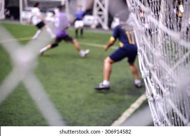 Soccer game action behind the soccer net
