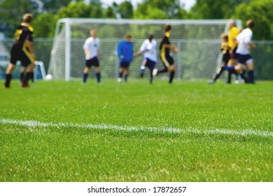 Soccer game capture with players, focus on sideline. See more soccer images in my portfolio.