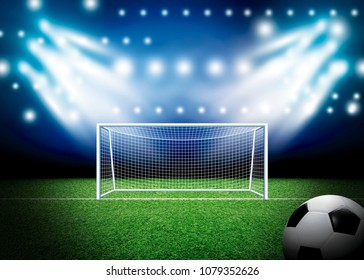 Soccer goal and football with spotlight background in stadium