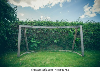 Soccer goal made of wood in a backyard