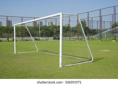 Soccer goal with net. Football goal on the field.