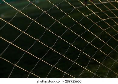 Soccer Goal Net with Green Grass Background