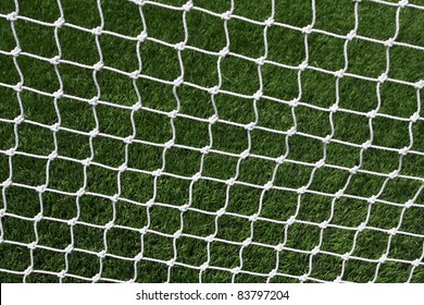 Soccer Goal Net with Green Grass Background