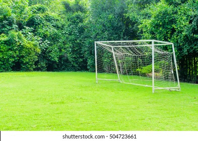Soccer goal on field green grass sunny day
