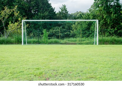 A soccer goal on the grass