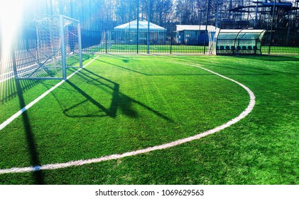 Soccer goal on green field with dramatic shadows background hd