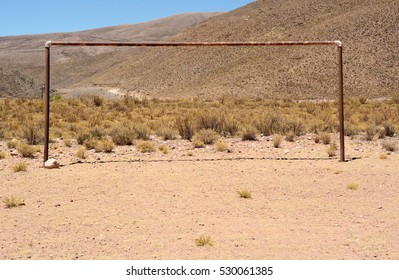 Soccer goal on a hill. Outdoors.