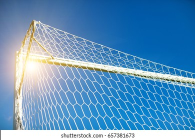 Soccer goal on the sky background, top corner