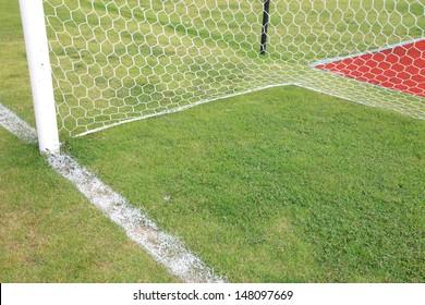 Soccer goal white football net, green grass