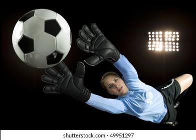 soccer goalie blocks ball in stadium