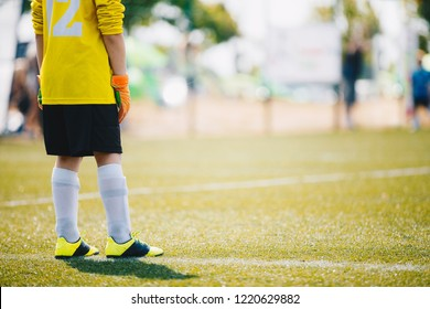 Soccer Goalkeeper on the Field. Football Training Game for Kids. Young Boy as a Football Goalkeeper Standing in a Goal. School Outdoor Sports Competition