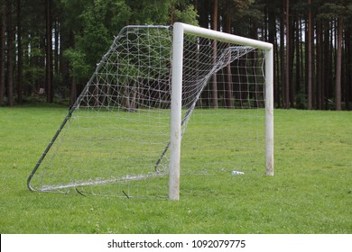 Soccer goalposts at a woodland football pitch in the forest.