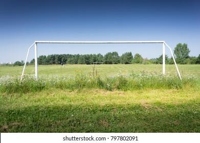 Soccer goals on a rural stadium.