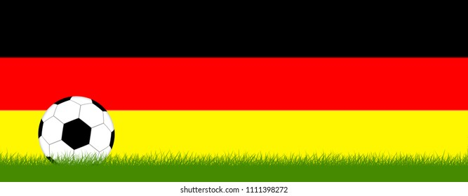Soccer on grass in front of Germany colors