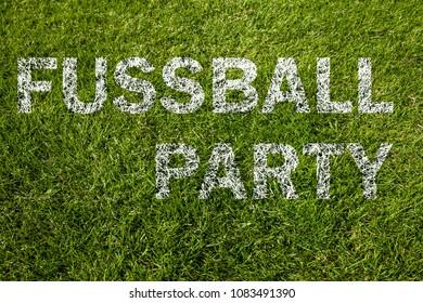 Soccer party written on meadow