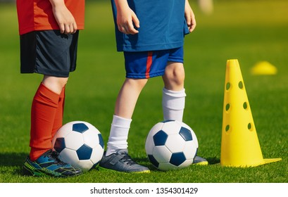 Soccer physical education lesson. Children training football on schools field. School athletic activities. Sports education for kids and youth