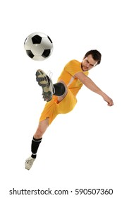Soccer player in action kicking ball isolated over white background