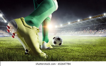 Photo of Soccer player in action. Mixed media
