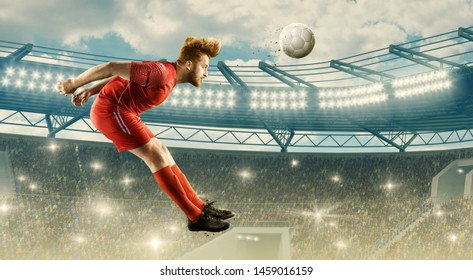 Soccer player in action on a stadium. Headed shot