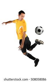 Soccer player back kicking ball isolated over white background