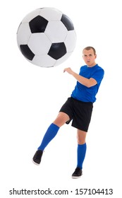 soccer player in blue uniform kicking ball isolated on white background