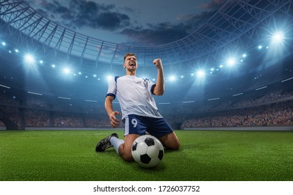 Soccer player celebrates a victory on the professional stadium . Stadium and crowd are made in 3D. - Shutterstock ID 1726037752