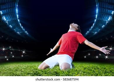 Soccer Player Celebrating Goal on field of Stadium Soccer Backgrounds