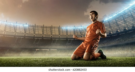 soccer player celebrating goal on a soccer stadium