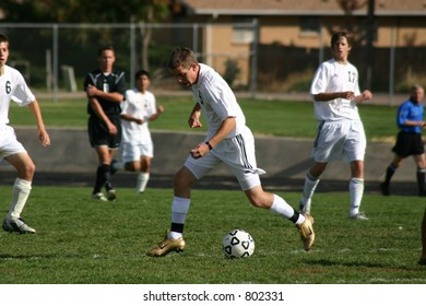 Soccer player controls the ball during play.  (Editorial use only)