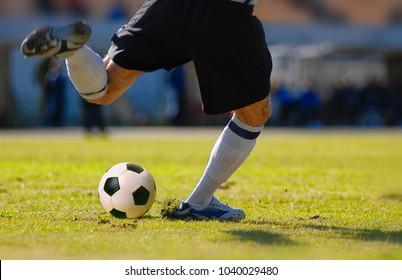 soccer player goalkeeper kick the ball during football match