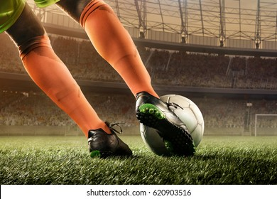 soccer player hits a ball