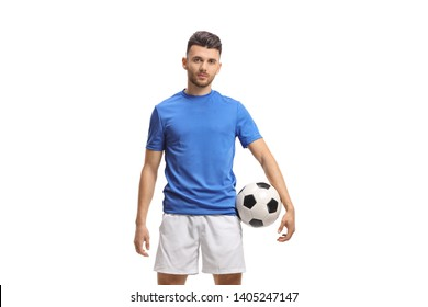 Soccer player holding a football and looking at the camera isolated on white background