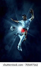 Soccer player kick a ball in jump