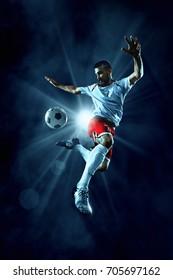 Soccer player kick a ball in jump