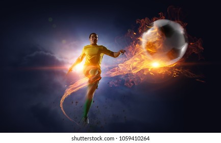Soccer player kicking ball. Mixed media
