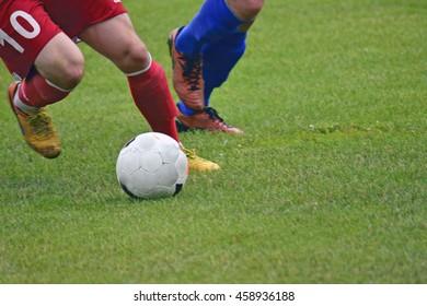 Soccer player kicking soccer ball on match