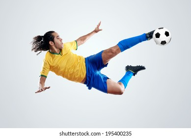 soccer player kicking ball towards goal for score and glory in brazil world cup