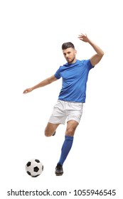 Soccer player kicking a football isolated on white background