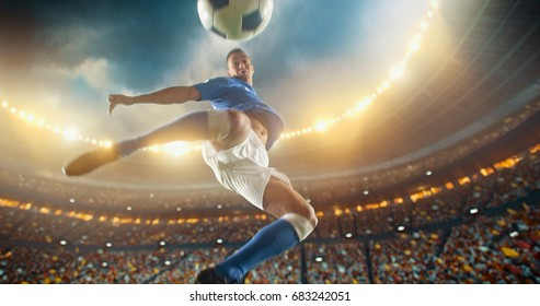 Soccer player kicks the ball with his feet in mod air during a soccer game on a professional outdoor soccer stadium. He wears unbranded soccer uniform. Stadium and crowd are made in 3D.